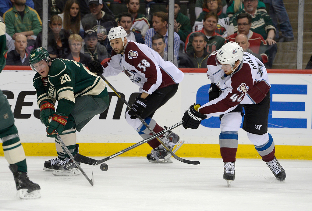 . Colorado Avalanche goalie Reto Berra (20) and Colorado Avalanche center Brad Malone (42) battle for the puck during the second period April 24, 2014 in Game 4 of the Stanley Cup Playoffs at Xcel Energy Center. (Photo by John Leyba/The Denver Post)