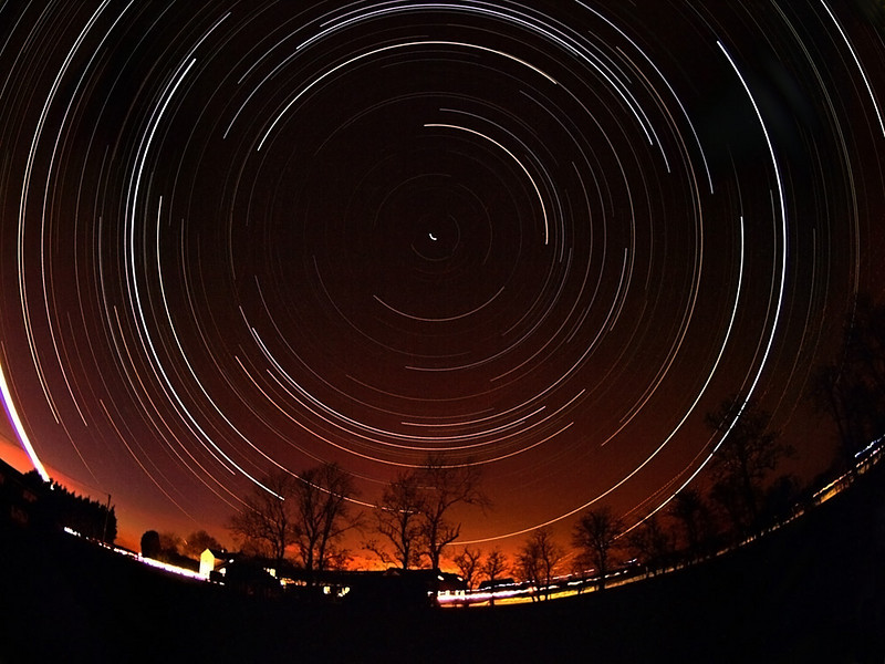 Startrail captured on March 29th 2009 in my backyard, Leics. For the first time in a long time clear skies were forecast all night. I set my Olympus E3 camera with 8mm fisheye lens in an adjacent field on tripod. Rigged up the extension lead to provide continuous power and left it running all night. 15s exposures on continuous shoot. Nearly 1500 images stacked and placed on a single layer in Startrails.de software.