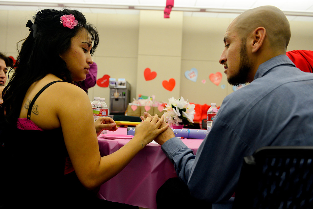 . DENVER, CO - FEBRUARY 14: Victor Manuel Villalobos Ramirez and Antonia Vanessa Carreon look at the groom\'s ring after they said their vows during a Valentine\'s Day marriage celebration at the Denver Clerk and Recorder\'s office. Couples applying for marriage licenses received gift bags containing gift certificates to local restaurants among other treats to celebrate their union. (Photo By AAron Ontiveroz/The Denver Post)