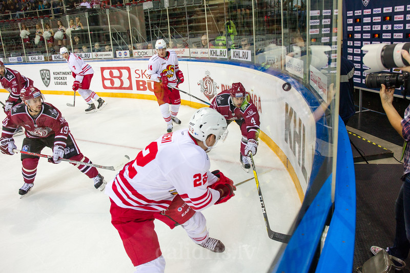 Mika Niemi (22) and Justin Shugg (4) reach for the puck at the boards in the KHL regular championship game between Dinamo Riga and Jokerit, played on September 13, 2016 in Arena Riga