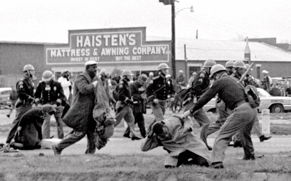 ". Alabama state troopers swing nightsticks to break up the ""Bloody Sunday\"" voting march in Selma, Ala., in this March 7, 1965, file photo. John Lewis, front right, of the Student Non-violent Coordinating Committee is put on the ground by a trooper. The Southern Christian Leadership Conference is inextricably tied to some of the civil rights movement\'s greatest accomplishments, from the 1963 March on Washington to the \""Bloody Sunday\"" march that led to the Voting Rights Act of 1965. Under the leadership of co-founder Martin Luther King Jr., the organization became a leading voice of a generation galvanized by sit-ins, protests and freedom rides.(AP Photo/File)"