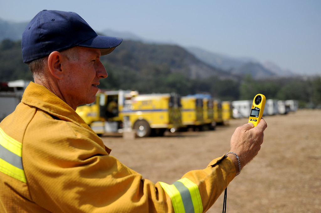 . Doug Kilpatrick, a firefighter with the Mountains Recreation & Conservancy Authority, checks the wind speed in Hidden Valley, Saturday, May 4, 2013. (Michael Owen Baker/Staff Photographer)