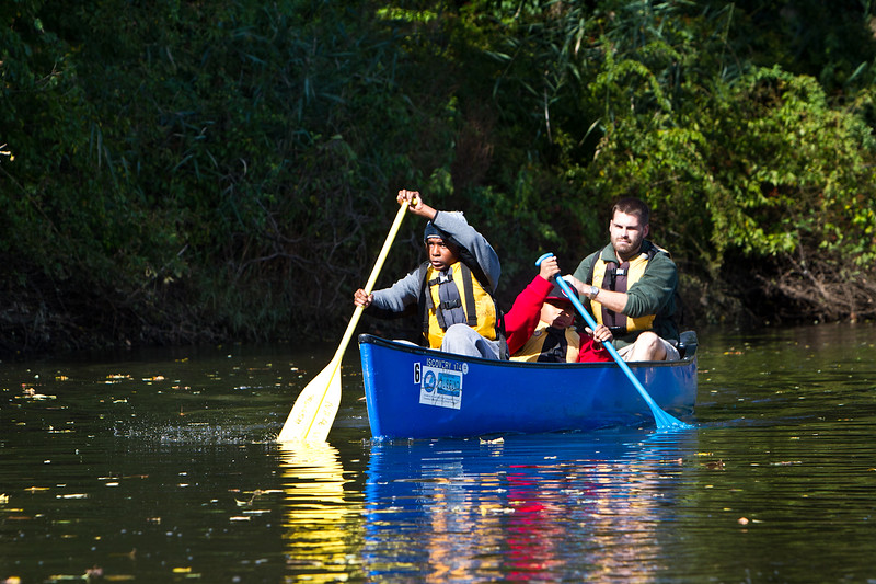 Barnard sixth graders Mikahl Glass and Xavier Segarra canoe on the West River with Joe Milone of the NH Parks Department.