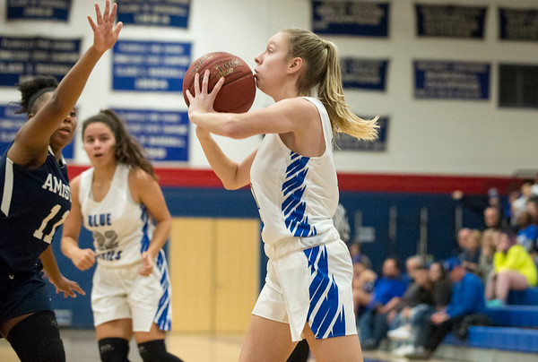 12/27/19 Wesley Bunnell | StaffrrPlainville girls basketball vs Amistad Academy on Friday night at Plainville High School. Olivia Wazorko (15) with a shot from the corner.