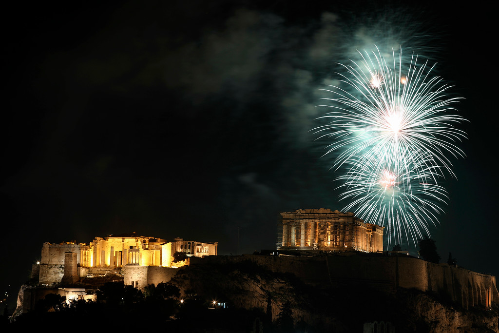 . Fireworks explode over the temple of the Parthenon at the Acropolis hill to mark the New Year\'s celebrations, in Athens, Greece, Monday, Jan. 1, 2018. (AP Photo/Yorgos Karahalis)