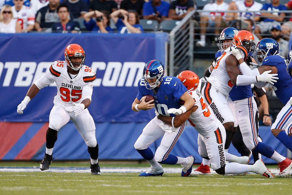. Cleveland Browns linebacker Mychal Kendricks (54) sacks New York Giants quarterback Eli Manning (10) during the first half of a preseason NFL football game Thursday, Aug. 9, 2018, in East Rutherford, N.J. (AP Photo/Adam Hunger)