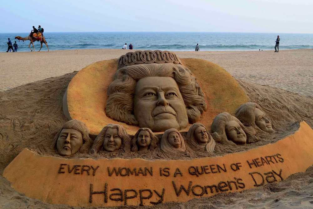 . A sand sculpture bearing portraits of women including Britain\'s Queen Elizabeth II, made by sand artist Sudersan Pattnaik, is pictured at at Puri beach, some 65 kilometers away from Bhubaneswar on March 7, 2014, on the eve of International Women\'s Day. The United Nations says only 40 percent of adult women are literate, and they are frequently the victims of violence and abuse. International Women\'s Day is marked on March 8 every year. (ASIT KUMAR/AFP/Getty Images)