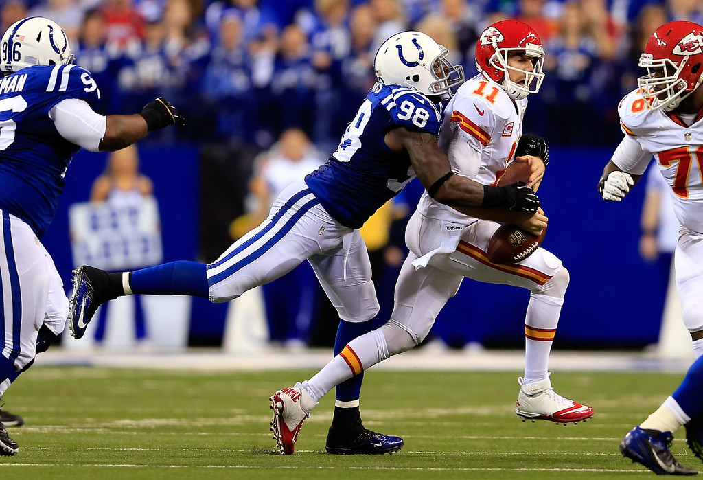 . INDIANAPOLIS, IN - JANUARY 04:  Outside linebacker Robert Mathis #98 of the Indianapolis Colts forces a fumble by quarterback Alex Smith #11 of the Kansas City Chiefs during a Wild Card Playoff game at Lucas Oil Stadium on January 4, 2014 in Indianapolis, Indiana.  (Photo by Rob Carr/Getty Images)