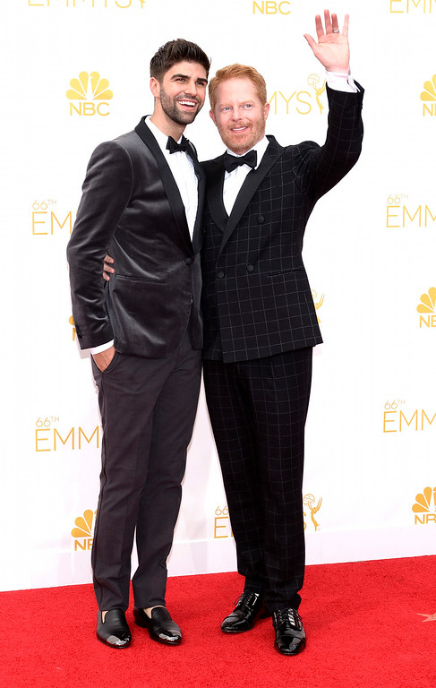 . Actor Jesse Tyler Ferguson and Justin Mikita on the red carpet at the 66th Primetime Emmy Awards show at the Nokia Theatre in Los Angeles, California on Monday August 25, 2014. (Photo by John McCoy / Los Angeles Daily News)