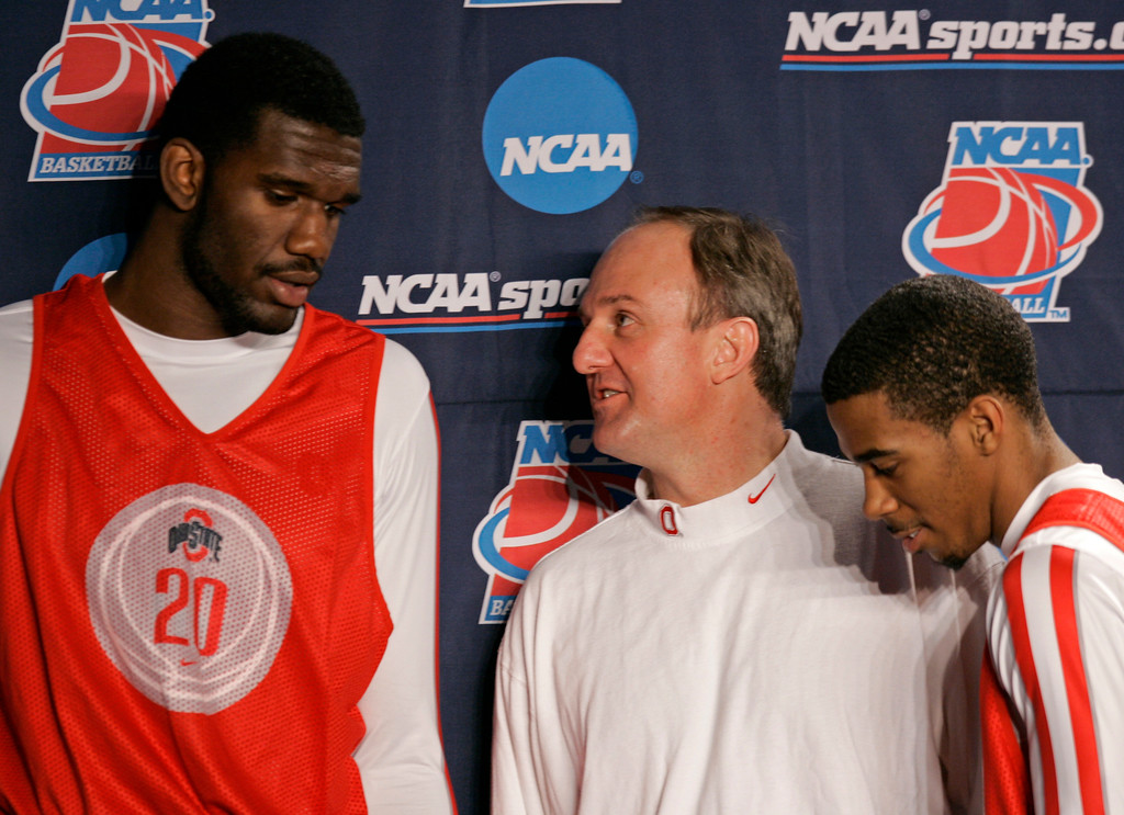 . Ohio State coach Thad Matta, center, chats with players Greg Oden, left, and Mike Conley Jr. as they met on the stage during a news conference in Lexington, Ky., Friday, March 16, 2007, for the second round of the South Regional of the NCAA Tournament. Ohio State faces Xavier in their second round game on Saturday. (AP Photo/Ed Reinke)