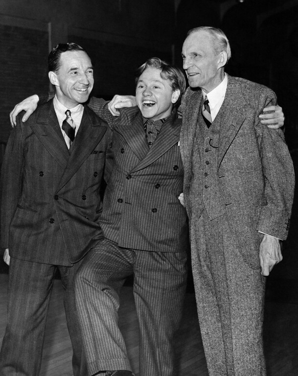 . Movie actor Mickey Rooney with an armful of millionaires and dancing a jig in Detroit on Feb. 9, 1940. With him are Edsel and Henry Ford. Rooney has the title role in a Thomas Edison film which will have its world premiere Saturday at Port Huron, Mich. Henry Ford and Edison were close friends. Rooney was a guest of the Fords. (AP Photo)
