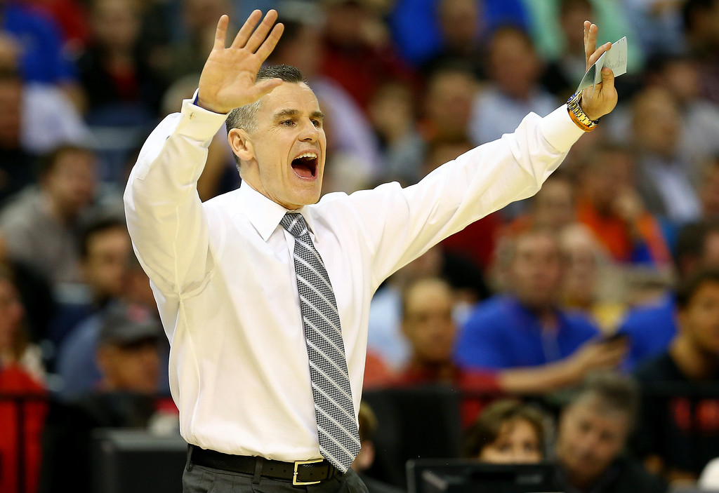 . Head coach Billy Donovan of the Florida Gators calls a play against the UCLA Bruins during a regional semifinal of the 2014 NCAA Men\'s Basketball Tournament at the FedExForum on March 27, 2014 in Memphis, Tennessee.  (Photo by Streeter Lecka/Getty Images)