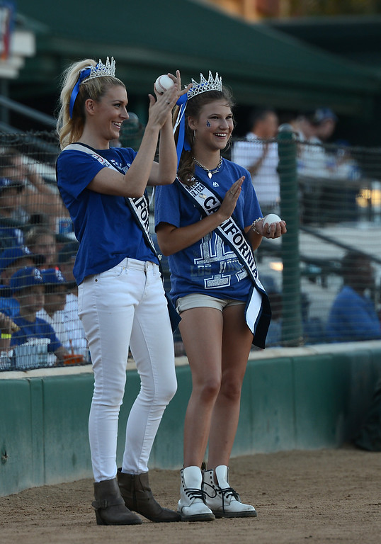 . Ms. California 2014 Sande Charles and Ms. Jr. Teen California Alina Carranza clap after they and Actor Fred Willard throw out the first pitches at the Quakes game at LoanMart Field in Rancho Cucamonga, CA, Friday, August 15, 2014. (Photo by Jennifer Cappuccio Maher/Inland Valley Daily Bulletin)