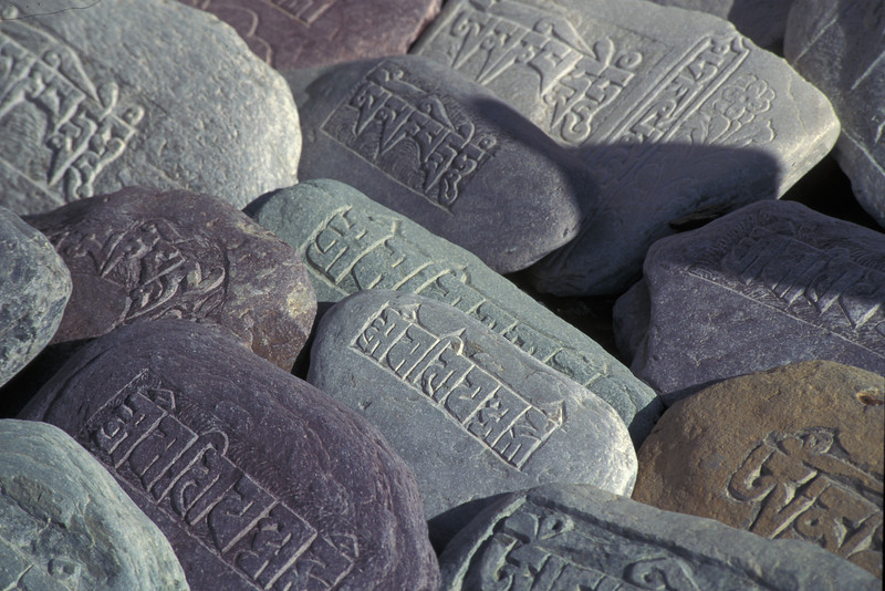 """Mani stones""  These stones are engraved with the Tibetan Buddhist Mantra ""Om Mani Padme Hum.""  Families have the stones engraved and then give them to the monastery.  They accumulate to huge piles over hundreds of years."