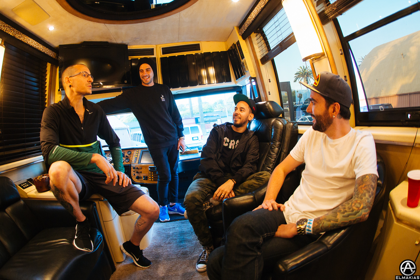 Chester, Mike and Jeremy talking on the bus later that night