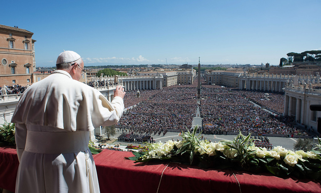 . In this photo provided by the Vatican newspaper L\'Osservatore Romano, Pope Francis waves to the crowd from the balcony of St. Peter\'s Basilica where he delivered the Urbi et Orbi (Latin for to the city and to the world) at the end of the Easter Mass in St. Peter\'s Square at the the Vatican Sunday, April 20, 2014. (AP Photo/L\'Osservatore Romano, ho)
