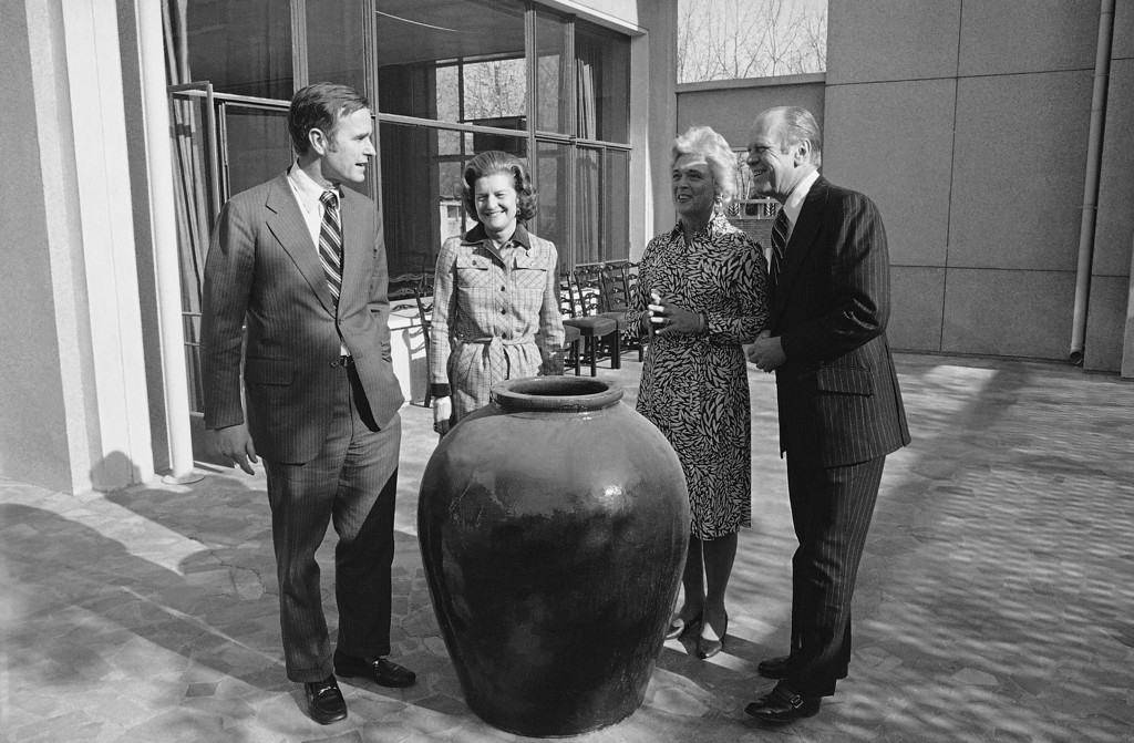 . President Gerald Ford, right, and first lady Betty Ford, second from left, visit with George Bush, chief of the United States Liaison office, and his wife Barbara at the U.S. Liaison in Peking, China, Dec. 4, 1975.  (AP Photo)