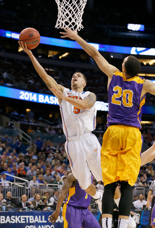 . ORLANDO, FL - MARCH 20:  Scottie Wilbekin #5 of the Florida Gators goes up for a shot against Gary Johnson #20 of the Albany Great Danes in the first half during the second round of the 2014 NCAA Men\'s Basketball Tournament at Amway Center on March 20, 2014 in Orlando, Florida.  (Photo by Kevin C. Cox/Getty Images)