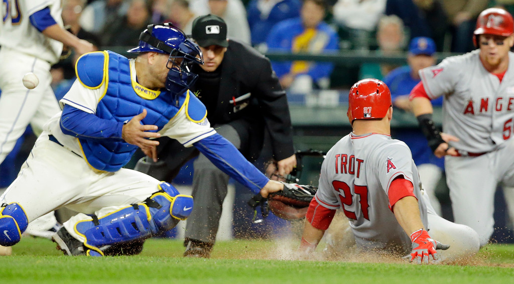 . Seattle Mariners catcher Chris Iannetta, left, bobbles the ball as Los Angeles Angels\' Mike Trout slides safely into home in the eighth inning of a baseball game, Sunday, May 15, 2016, in Seattle. Trout scored on a two-run single by Angels\' Daniel Nava. (AP Photo/Ted S. Warren)