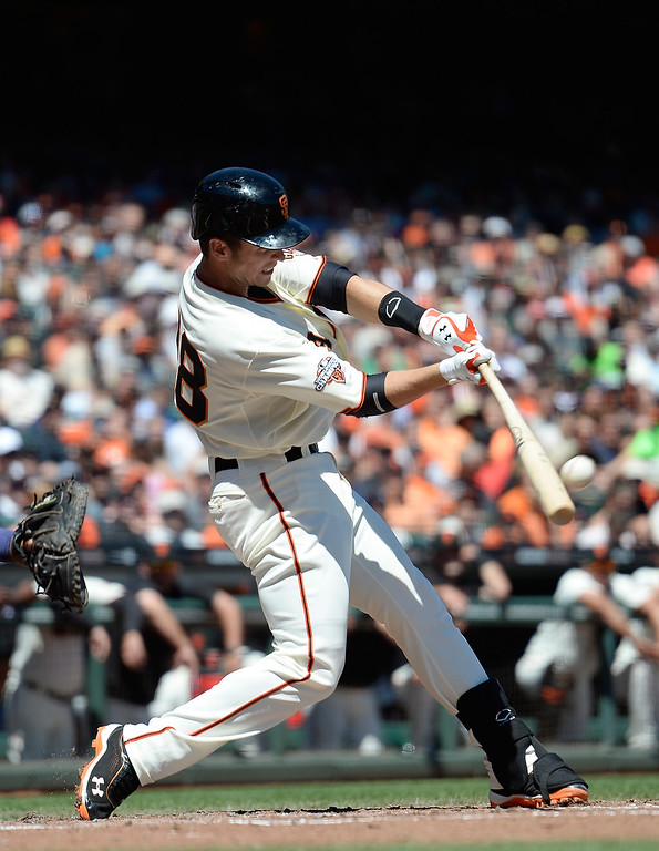 . Buster Posey #28 of the San Francisco Giants hits an RBI double driving in pitcher Barry Zito #75 against the Colorado Rockies in the second inning at AT&T Park on April 10, 2013 in San Francisco, California.  (Photo by Thearon W. Henderson/Getty Images)