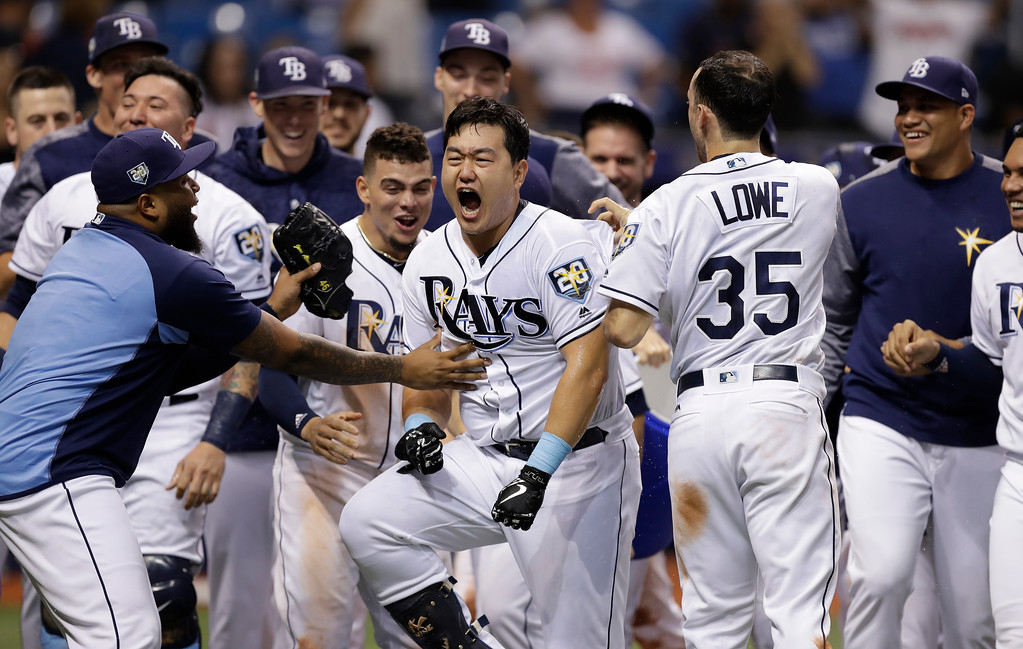 . Tampa Bay Rays\' Ji-Man Choi, of South Korea, center, celebrates his two-run walk-off home run off Cleveland Indians pitcher Brad Hand during the ninth inning of a baseball game Monday, Sept. 10, 2018, in St. Petersburg, Fla. (AP Photo/Chris O\'Meara)