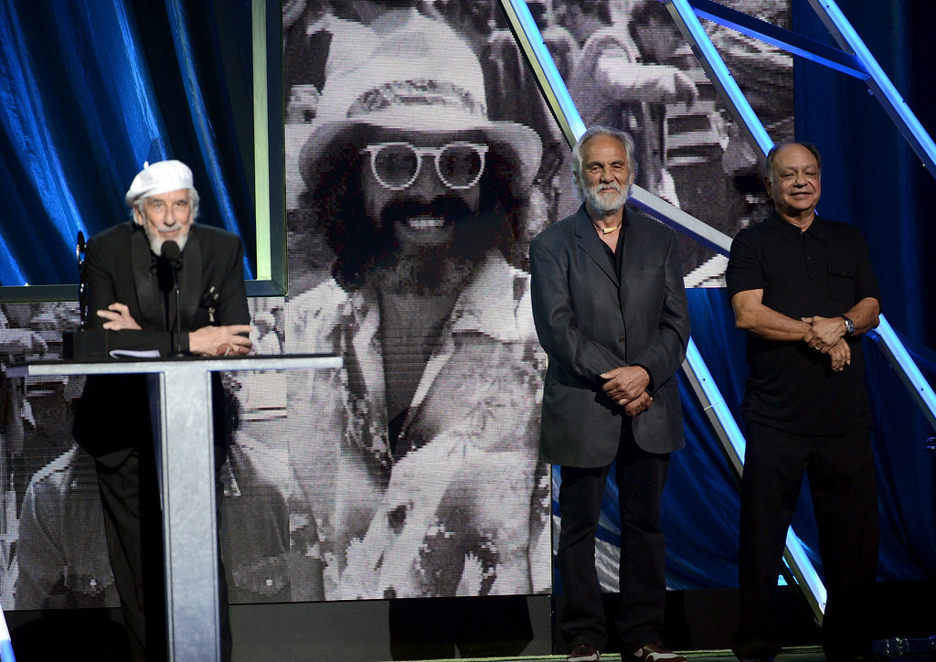 . Inductee Lou Adler accepts the Ahmet Ertegun Award from presenters Tommy Chong and Cheech Marin onstage at the 28th Annual Rock and Roll Hall of Fame Induction Ceremony at Nokia Theatre L.A. Live on April 18, 2013 in Los Angeles, California.  (Photo by Kevin Winter/Getty Images)