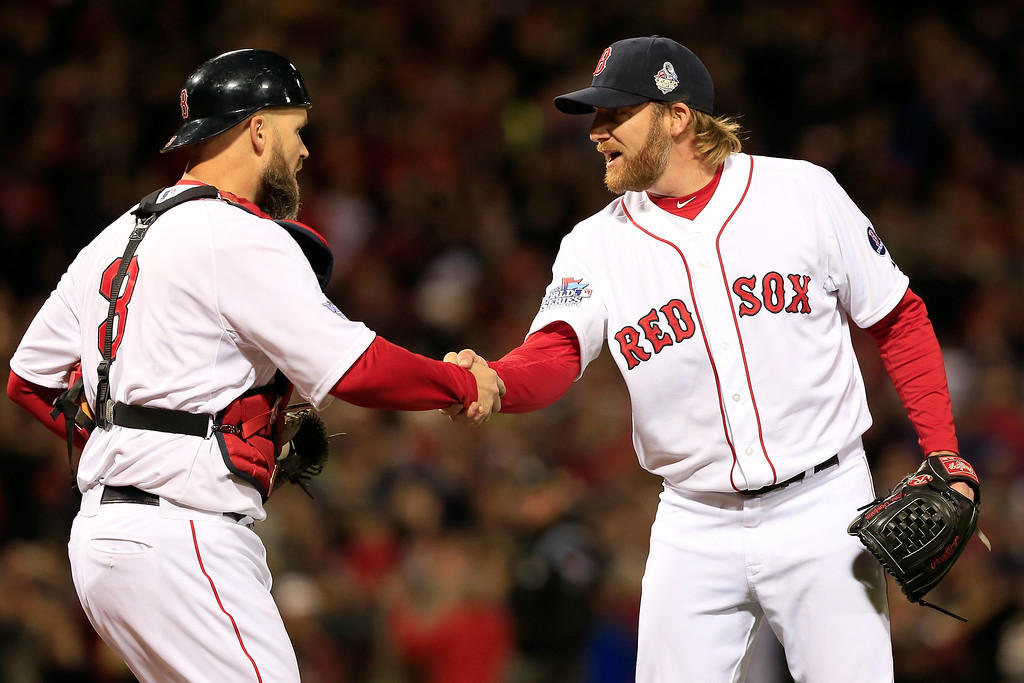 . Ryan Dempster #46 and David Ross #3 of the Boston Red Sox celebrate after defeating the St. Louis Cardinals 8-1 in Game One of the 2013 World Series at Fenway Park on October 23, 2013 in Boston, Massachusetts.  (Photo by Jamie Squire/Getty Images)