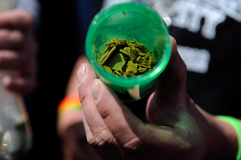. A marijuana enthusiast shows off a container of wax made in Wheat Ridge during the final day of the first ever High Times US Cannabis Cup at the Exdo Center in Denver on Sunday, April 21, 2013. Seth A. McConnell, The Denver Post