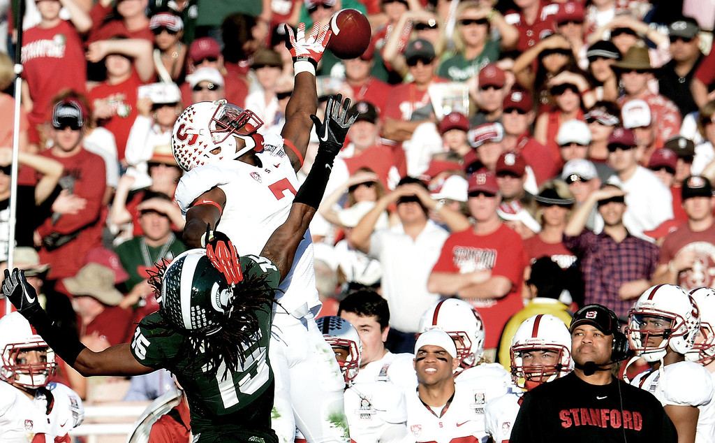 . Stanford wide receiver Ty Montgomery (7) can\'t reach a pass as Michigan State cornerback Trae Waynes (15) defends in the first half of the 100th Rose bowl game in Pasadena, Calif., on Wednesday, Jan.1, 2014. 