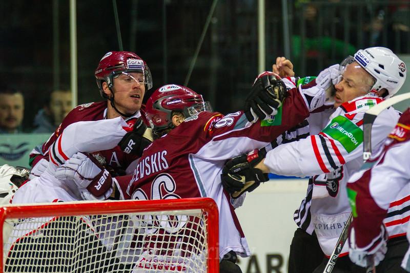 Maris Bicevskis (96) of Dinamo Riga in fight hits Peter Podhradsky (37) of Donbass Donetsk during KHL regular championship game between Dinamo Riga and Donbass Donetsk in Arena Riga