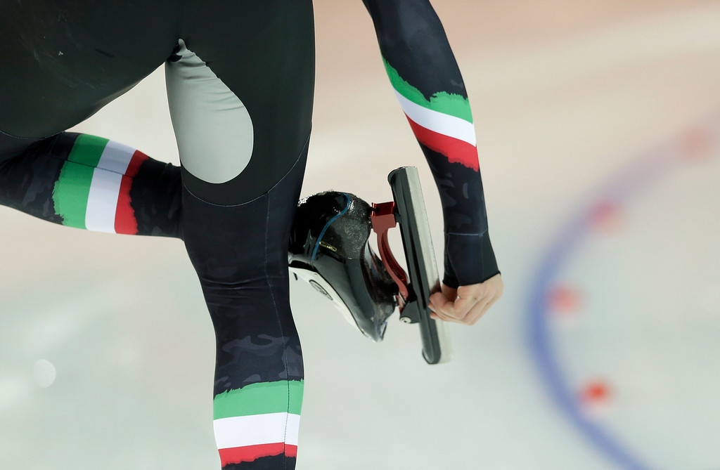. Matteo Anesi of Italy adjusts his skates as he competes in the men\'s 1,500-meter speedskating race at the Adler Arena Skating Center during the 2014 Winter Olympics in Sochi, Russia, Saturday, Feb. 15, 2014. (AP Photo/Patrick Semansky)