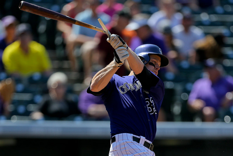 . Justin Morneau #33 of the Colorado Rockies breaks his bat on a ground out during the seventh inning against the San Francisco Giants at Coors Field on September 1, 2014 in Denver, Colorado. The teams were resuming a game previously suspended in the sixth inning on May 22 due to rain.  (Photo by Justin Edmonds/Getty Images)