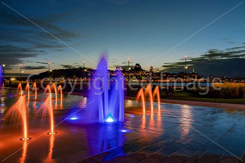 Illuminated fountains across the river from Quebec