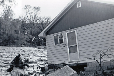 Spearfish Creek out of its banks and wreaking havoc with homes along the way, including this one at 441 3rd Street.  May 1965 flood - Spearfish, SD.
