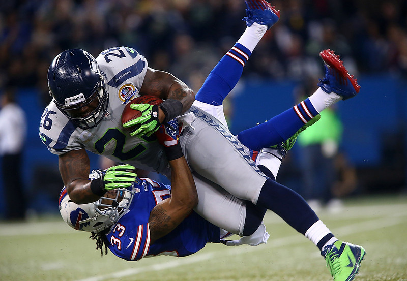 . Michael Robinson #26 of the Seattle Seahawks is tackled during an NFL game by Ron Brooks #33 of the Buffalo Bills at Rogers Centre on December 16, 2012 in Toronto, Ontario, Canada. (Photo by Tom Szczerbowski/Getty Images)