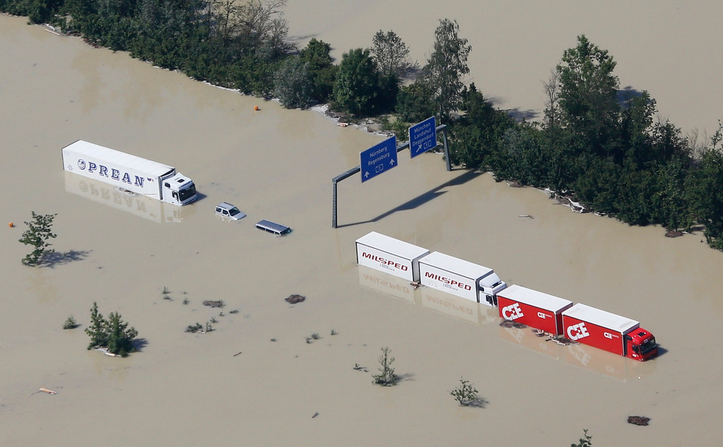 . Trucks stand stranded on the flooded motorway A3 near the eastern Bavarian city of Deggendorf June 5, 2013, after one of Europe\'s most frequented highways was flooded by the nearby river Danube on June 4.   REUTERS/Wolfgang Rattay