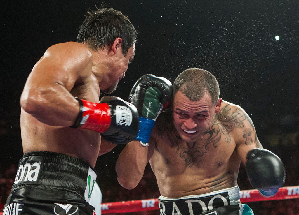 . Mike Alvarado, right, and Juan Manuel Márquez, of Mexico, exchange punches in the sixth round of a WBO welterweight title boxing match at the Forum in Inglewood, Calif., Saturday, May 17, 2014. Márquez won the title.  (AP Photo/Ringo H.W. Chiu)