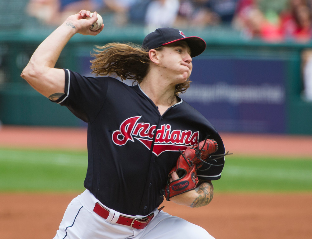 . Cleveland Indians starting pitcher Mike Clevinger delivers to Minnesota Twins\' Joe Mauer during the first inning of a baseball game in Cleveland, Thursday, Aug. 30, 2018. (AP Photo/Phil Long)