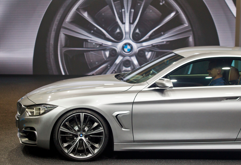 . The BMW 4 Series Coupe concept vehicle is unveiled at the North American International Auto Show, Monday, Jan. 14, 2013, in Detroit, Mich. (AP Photo/Tony Ding)