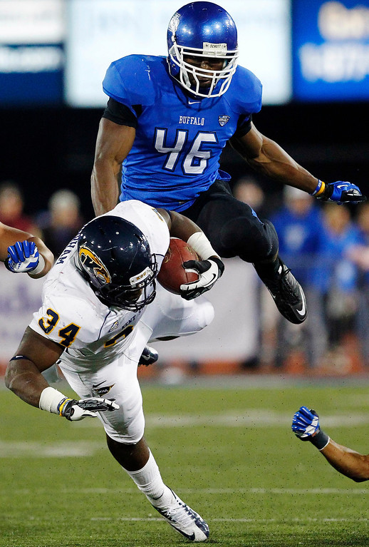 . In this Sept. 19, 2012, file photo, Buffalo\'s Khali Mack (46) brings down Kent State\'s Trayion Durham (34) during the first half of an NCAA college football game in Amherst, N.Y. Mack was selected fifth overall in the first round of the NFL football draft by the Oakland Raiders(AP Photo/Bill Wippert, File)