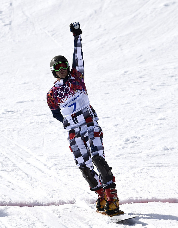 . Gold Medallist, Russia\'s Vic Wild celebrates at the Men\'s Snowboard Parallel Giant Slalom Final at the Rosa Khutor Extreme Park during the Sochi Winter Olympics on February 19, 2014.  FRANCK FIFE/AFP/Getty Images