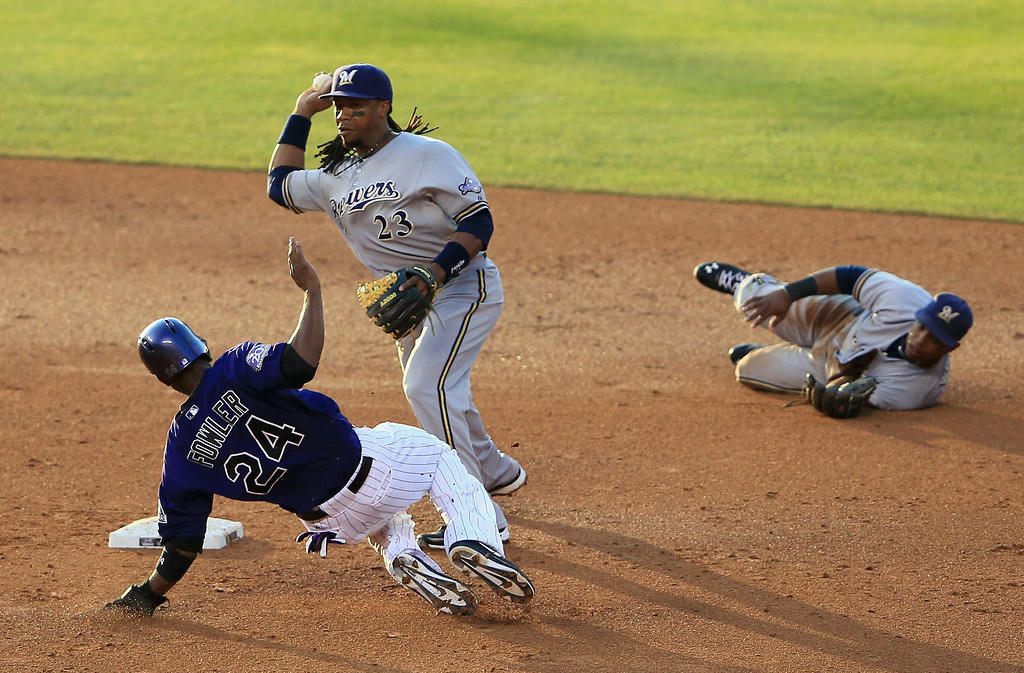 . DENVER, CO - JULY 26:  Second baseman Rickie Weeks #23 of the Milwaukee Brewers gets a force out on Dexter Fowler #24 of the Colorado Rockies on a ground ball hit by DJ LeMahieu #9 of the Colorado Rockies to shortstop Jean Segura #9 of the Milwaukee Brewers for the second out of the second inning at Coors Field on July 26, 2013 in Denver, Colorado.  (Photo by Doug Pensinger/Getty Images)