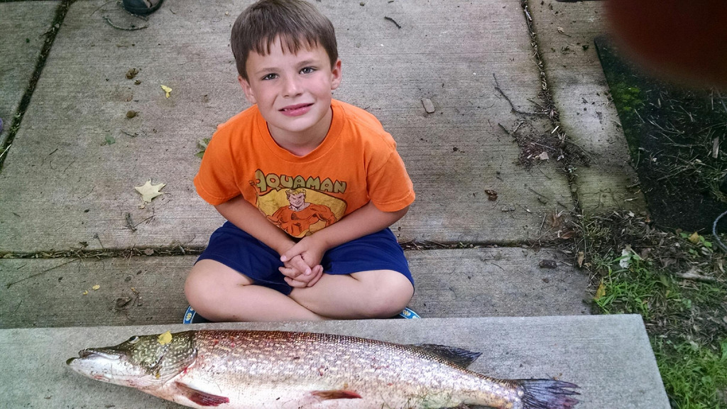 . Six-year-old Conner Holmen caught this 14-pound northern July 26 near Luck Wis. (Courtesy photo)