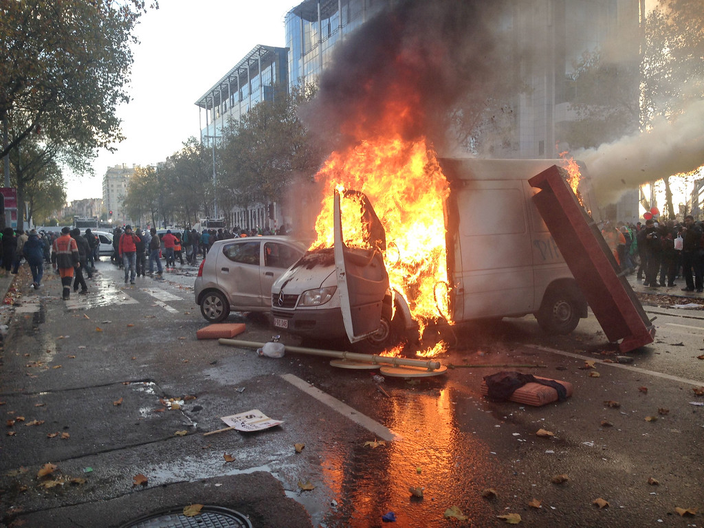 . Demonstrators set fire on a truck during riots between few demonstrators and police, at the end of a national demonstration in Brussels, on November 6, 2014. The Belgian unions called for a big demonstration in the Belgian capital to protest against the plans of the Michel I government. AFP PHOTO / BELGA / SIMON VAN DORPE /AFP/Getty Images