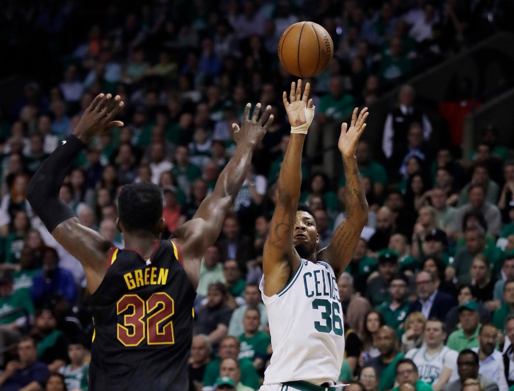 . Boston Celtics guard Marcus Smart (36) shoots over Cleveland Cavaliers forward Jeff Green (32) during the fourth quarter of Game 5 of the NBA basketball Eastern Conference finals Wednesday, May 23, 2018, in Boston. (AP Photo/Charles Krupa)