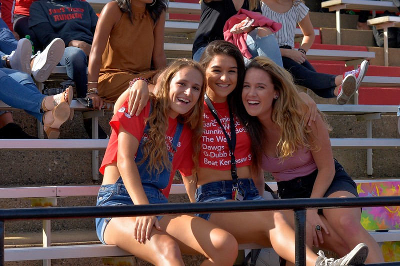 football-fans-students-smiles.jpg