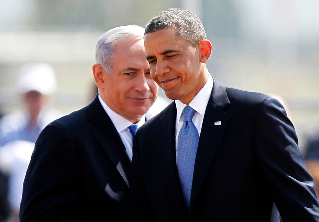 . U.S. President Barack Obama (R) and Israeli Prime Minister Benjamin Netanyahu walk during an official welcoming ceremony at Ben Gurion International Airport near Tel Aviv March 20, 2013.REUTERS/Nir Elias