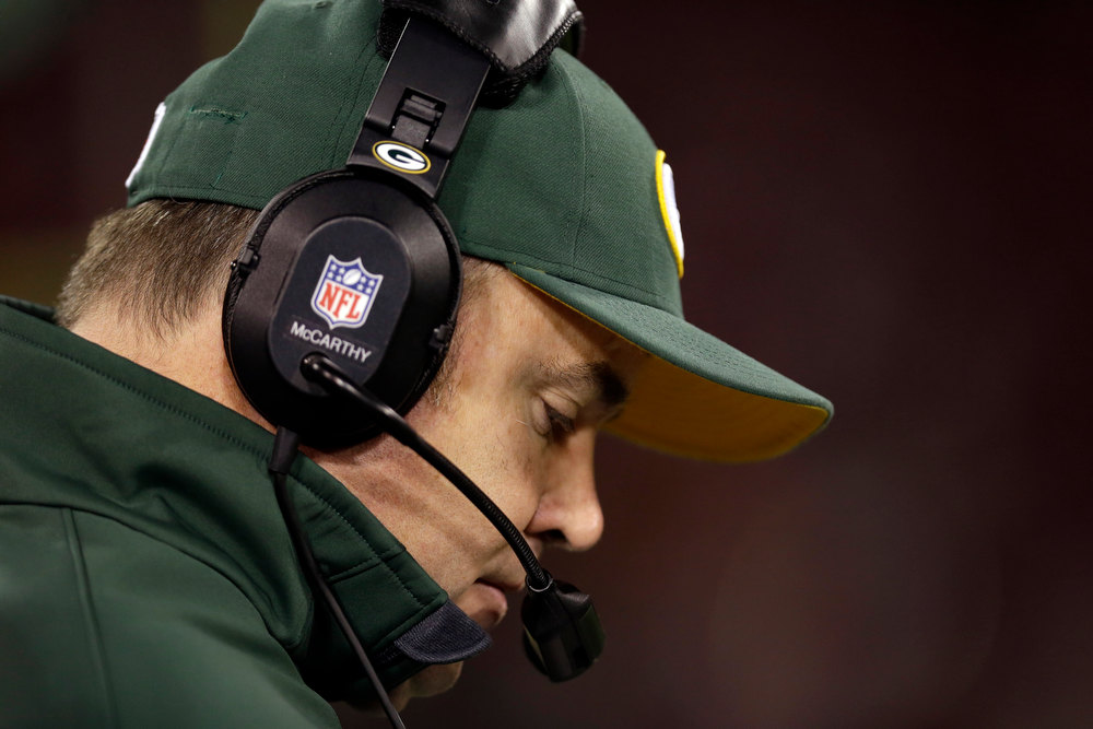 Description of . Green Bay Packers head coach Mike McCarthy stands on the sideline during the fourth quarter of an NFC divisional playoff NFL football game against the San Francisco 49ers in San Francisco, Saturday, Jan. 12, 2013. (AP Photo/Marcio Jose Sanchez)