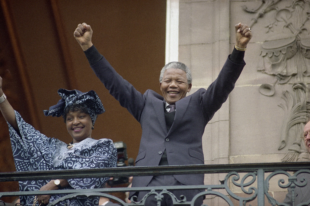 . In this June 13, 1990 file photo, Deputy leader of the African National Congress Nelson Mandela and his wife Winnie wave from a Strasbourg\'s Town Hall balcony.  (AP Photo/Christian Lutz, file)