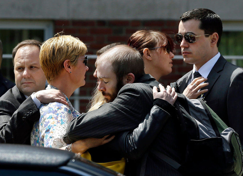 . Mourners hug as they leave the funeral for Boston Marathon bomb victim Krystle Campbell, 29, at St. Joseph\'s Church in Medford, Mass. Monday, April 22, 2013. Hundreds of family and friends packed the church in Medford, Mass., for Campbell\'s funeral, while dozens more waited outside after being turned away. (AP Photo/Elise Amendola)